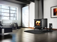 The 2300 Wood Stove with Blower by Osburn offers a high end wood stove designed for maximum heat output. The 2300 Series wood stove is a new generation wood stove with an contemporary design accented with a sleek cast-iron door. The Osburn 2300 is an EPA Free Standing Wood Stove, Wood Stoves For Sale, Refractory Brick, Stove Fireplace, Iron Doors, Cool Beds, Log Homes, Tiny Homes, Sustainable Living