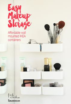 These pod-like IKEA containers hold makeup items on your bathroom wall.