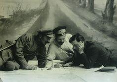 Semyon Budyonny, Mikhail Frunze and Kliment Voroshilov over a map, 1920.