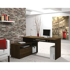 @Overstock - This compact L-shaped desk is perfect for small spaces. The elegance of the tuxedo or maple finish will give a modern look to your work environment. This trendy two layer workstation with an oversized pedestal is fully reversible for more flexibility.http://www.overstock.com/Office-Supplies/Bestar-Modula-L-Workstation/6230693/product.html?CID=214117 $324.99