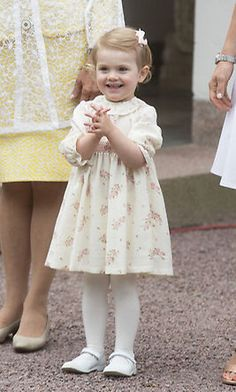 July 2014: Celebrating her mommy! Estelle couldn't help but smile during Crown Princess Victoria's 37th birthday party.   Photo: © Getty Images