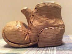 Ive been whittling since 1977, this shoe is carved out of butternut . The tools I used were a bandsaw to cut shape out, drill to make hole where the foot would go, carving knife to whittle, a wood burner, and finish. It takes many hours, but I enjoy it. Shoe is 3 1/4 x 1 3/8 x 2 high.
