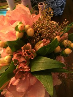 Hybrid bouquet by Graceful wedding co: coffee filter flowers live hypericum and live Alstromeria and seeded eucalyptus