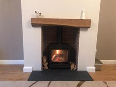 Grisedale installed into a brick slip chamber. Built chimney breast with blocks, dot and dab plasterboard. Oak beam. Twin-wall flue system.