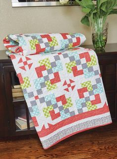 Pixie Pathways quilt pattern: Simple blocks in a classic setting will have you snuggling under this delightful quilt in no time. The quilt was designed by Kate Colleran.
