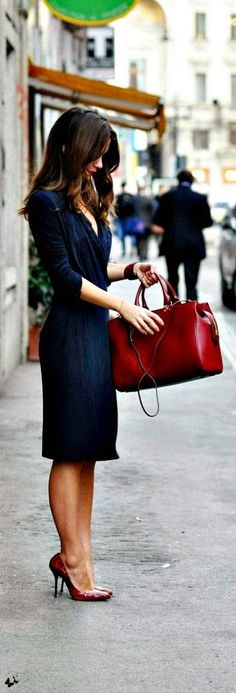 Comfortable navy long sleeve wrap work dress. Brown bag and red pumps for business formal look.