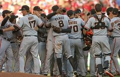 Love It! Members of the San Francisco Giants including Aubrey Huff #17, Hunter Pence #8, George Kontos #70 and Buster Posey #28 celebrate with teammates after a win against the Cincinnatti Reds in Game Five of the National League Division Series at the Great American Ball Park on October 11, 2012 in Cincinnati, Ohio. The Giants defeated the Reds 6-4.