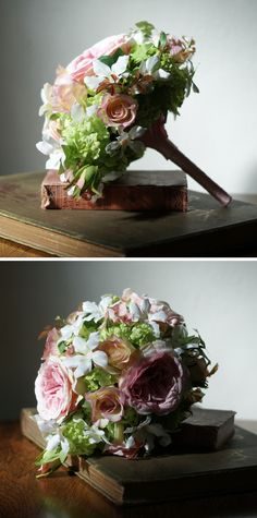 Petite silk bouquet of pink cabbage and small roses, white stephanotis and lime green viburnum flowers with a pink satin ribbon covered handle