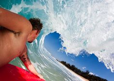 Another of Mr Collins' pictures shows him bodyboarding inside a wave in Oahu, Hawaii