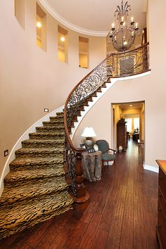 I absolutely love the rod iron design on the staircase.