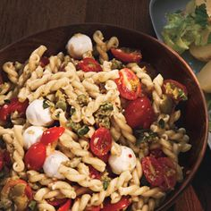 Pasta Salad with Cherry Tomatoes and Green Olivada Recipe Salads with garlic cloves, green olives, capers, red wine vinegar, anchovy paste, dijon mustard, crushed red pepper, extra-virgin olive oil, gemelli, cherry tomatoes, fresh mozzarella balls, water, fresh oregano