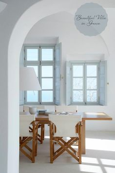 Beautiful Casual Dining Room...like chairs and shutters.