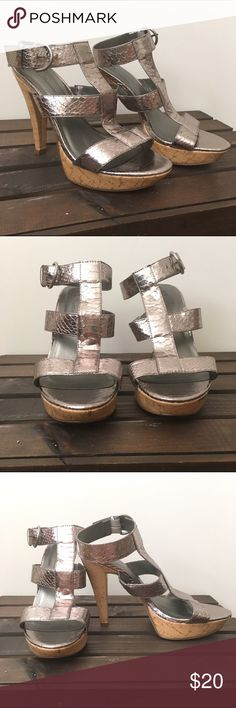 Chinese Laundry Metallic Gladiator Heels Cork and Metallic Platform Gladiator Heels. Snake skin texture to the metallic portions. Buckle straps. Worn a handful of times. Chinese Laundry Shoes Heels
