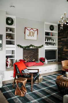 pillow trimmed in leather warm up the hearth.  Add poinsettas while your at it.  And love the rug. :-) 2015 Holiday Home Tour | Suburban Bitches