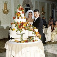 "Posted By Carlos Bakery ""Happy Anniversary to Buddy and Lisa! Check out their wedding photo and their cake! from the big day 12 years ago. Congratulations from your Carlo's Balkery Famiglia! Cake Boss Bakery, Carlos Bakery Cakes, Luxury Wedding Cake, Wedding Cakes, Cake Boss Family, Peacock Cupcakes, Cake Boss Buddy, Buddy Valastro, Master Baker"