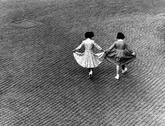 View from a window: Dance of the Dresses. Via della Lungarina. Trastevere, Rome, Italy. 1953. © Herbert List / Magnum Photos