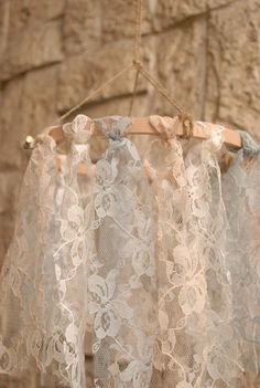 Create lace fabric chandeliers. These chandeliers are dainty and pretty. They go well as decors for rustic and shabby chic themed weddings. Imagine your garden ceremony/reception filled with these flowing and pretty things, eye candy right?