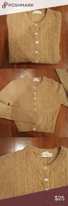 Caramel colored cropped cable knit cardigan, haha! Say that three times, quickly :) And, that says it all, pretty much. Long sleeve, crew neck button down, cropped cardigan sweater. 100% Wool. Excellent condition! Banana Republic Sweaters Cardigans