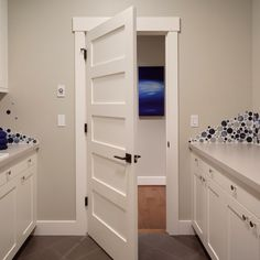 We like the door molding/trim with the larger board to cap the top.