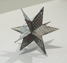 DIY star. Can see making some of these to hang on the tree or to have hanging down maybe from the chandelier.