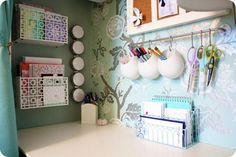 repurposed ikea kitchen rack for desk organization ... would work for sewing also (scissors, seam rippers, etc) ... Check out the magnetic spice cans on the wall too --more organization. I like these white ikea Asker containers for the bath also