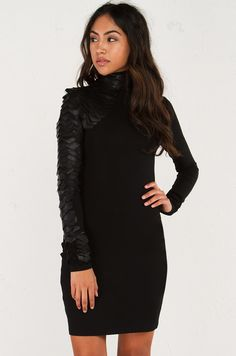 Front view of Turtleneck Long Sleeve  knee length  bodycon  dress with  snake scale detail  in Black.