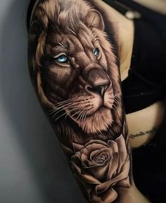 lion-head-with-blue-eyes-rose-underneath-shoulder-tattoo-lion-sleeve-tattoo-on-w. - lion-head-with-blue-eyes-rose-underneath-shoulder-tattoo-lion-sleeve-tattoo-on-woman-wearing-black- - Lion Sleeve, Lion Tattoo Sleeves, Best Sleeve Tattoos, Sleeve Tattoos For Women, Tattoo Sleeve Designs, Tattoos For Guys, Mens Tattoos, Tattoo Sleves, Lion Tattoo Meaning