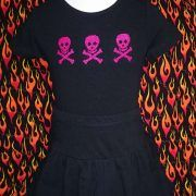 $14.95      Pink Skulls     Size 2  Black stretchy cotton T-shirt hand sewn with a trio of shiny pink skull and crossbones.  The skirt pictured is not included in the price but can be sewn with the same motif to match..  Great for Halloween or just for being a little different.