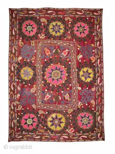 A vibrant Antique Uzbek Shahrisabz region silk Suzani / Susani embroidery. The piece dates to early 1900s maybe a bit older. It has the classical central medallion with four boteh design elaborated ...