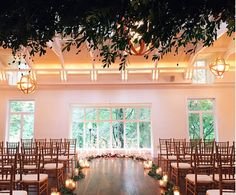 ceremony facing window of Pomme. M2 Photography, Oleander Florals