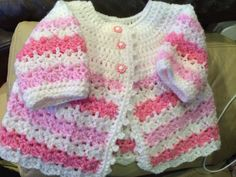Crocheted cardigan for baby girl 0-3 months.