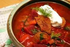 Beggars Borscht  .... Serves 6 .. (2.2 lb) beef stew meat * 3 tbsp olive oil ** 1 large yellow onion, 5 ribs celery, 5 cloves garlic, 1 tsp caraway seed, 3 large  (1.5 lb) white potatoes, 2 large (3/4 lb) carrots, 4-5 medium (1.5 lb) beets = with greens attached, 1 can (28 oz) diced tomatoes, 2 cups beef stock OR water, 2 tbsp red wine vinegar, 1 bay leaf, small handful fresh dill (~1/4 cup minced), salt and pepper, to taste, 1/2 cup sour cream, optional garnish