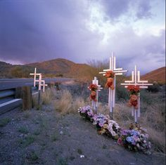 roadside crosses - descansos - mark the place where people have died, probably due to an accident, New Mexico. Descansos are protected by law in New Mexico.