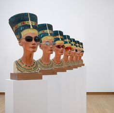 Nefertiti, 2014. 7 plaster busts of glasses, wood, wood pedestals with wheels, each 190.7 x 40 x 50 cm;  Courtesy Galerie Buchholz, Cologne / Berlin / New York, David Zwirner, New York / London and Hauser & Wirth.  © Isa Genzken, VG Bild - Kunst, Bonn 2016