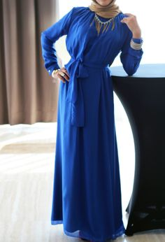 Royal blue chiffon topped off with golden silk hijab and gold accessories. — at Le Crystal Reception Hall.