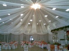 Tulle Ceiling drape with Christmas lights #weddings #bridesclub