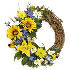 """Sunflower Lilly Yellow and Blue Silk Wreath - Decorate your Entry Door with this beautiful silk flower wreath created with sunflowers, daisies, and lillies, grasses. Created in a crescent shape displaying the lovely vines. Accented with a colorful butterfly. This silk flower wreath is created on a grapevine wreath base made in the US. Measures 19"""""""
