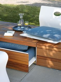 Low designed by 13&9 for Viteo - A unique range of shaped Corian exterior leisure furniture, with optional iroko bases.