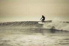 Andy Nieblas giving a 5'4 Mini-Simmons a go, at 54th street, Newport Beach.  Photos: Cameron Oden