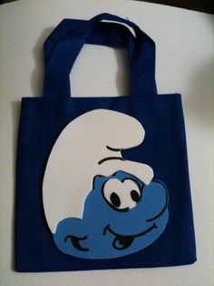 Smurf treat bag for party Trace your favorite character into Foam and glue it to the bags with a glue gun. The bags can be found at Michaels comes on 3/1 or 2/1 depending on color