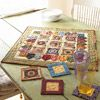 Scrappy Floral Applique Table Mat.    Raid your stash to make this table mat and matching coasters.
