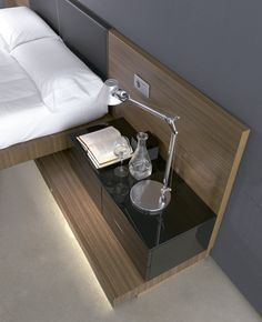 BLACK MODERN NIGHTSTANDS | Long and black, this modern nightstand is part of the master bed. The perfect piece to storage things | http://masterbedroomideas.eu #luxuryfurniture #interiordesign #masterbedroomideas