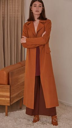 Vegan suede robe coat with tie in Potter's Clay. No hardware, centre front tie closure. Pointed lapel collar and two oversize slip pockets at natural waist. Super soft suede feel. Straight hem. Design