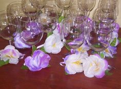 Wine Glass Decor I made from leis and ribbons....  Easy and Cheap!