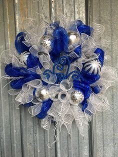 "24"" Silver and Blue Chrismas Wreath with Ornaments & Floral Picks by CCsDesignsBoutique on Etsy https://www.etsy.com/listing/487868909/24-silver-and-blue-chrismas-wreath-with"