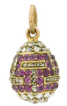 A Fabergé jeweled egg pendant, workmaster Michael Perchin, St. Petersburg, circa 1895, set with diamonds and rubies in a Greek key pattern, the suspension ring partially struck with workmaster's initials, the ring with 56 standard