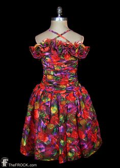 Vintage Oscar de la Renta velvet floral stamped sheer organdy cocktail or party dress with ruched and ruffled bodice and crossed straps. Measures