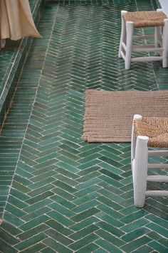 Herringbone green floor tiles
