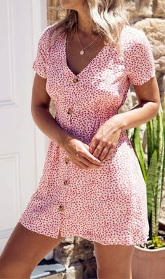 Tea dresses are completely on trend and there's no better way to wear it than in our floral print button through dress. It features a deep V-collar, short sleeves with elastic cuffs and button through front detail.