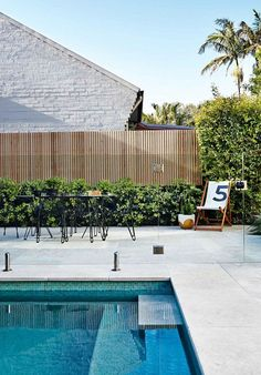 Pool and Landscape Design . Pool and Landscape Design. 5 Ideas for A Simple and Refined Garden Design Pool Fence, Backyard Fences, Pool Paving, Fence Around Pool, Cement Pavers, Glass Pool Fencing, Courtyard Pool, Cement Garden, Concrete Fence